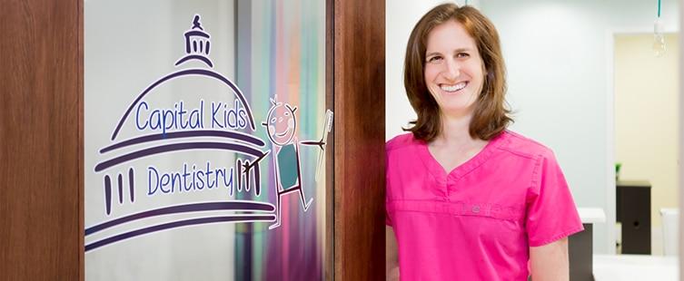Dr. Jessica Rubin standing by door of Capital Kids Dentistry
