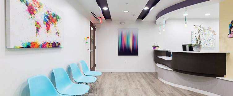 dental reception area with turquoise seats