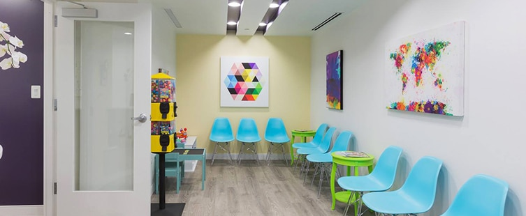 dental reception area with turquoise seats and kids play table